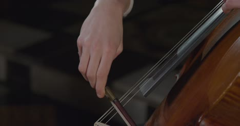 Close-Up-Of-A-Male-Cellist-Performing