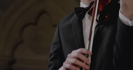 Close-Up-Of-Male-Using-Bow-To-Play-Violin