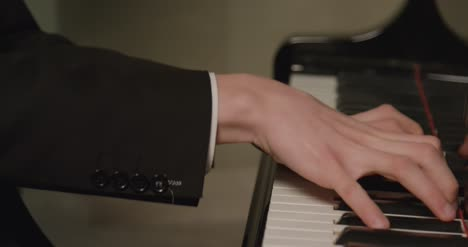 Close-Up-Hands-Of-Male-Pianist-Playing-The-Piano