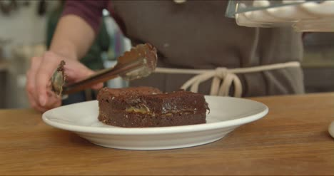 Serving-a-Portion-of-Chocolate-Brownie-Cake