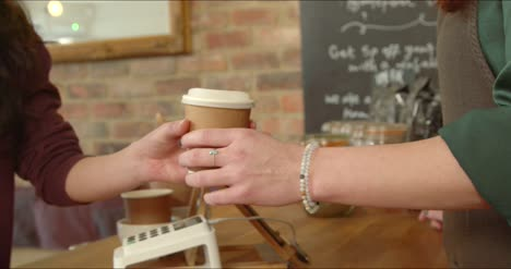 Handing-Coffee-to-Customer-in-Cafe-02
