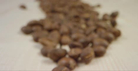 Close-Up-of-Coffee-Beans-Dropping-on-Other-Beans