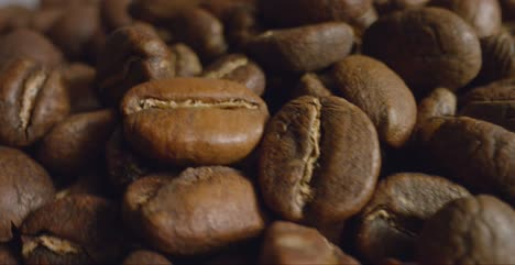 Macro-Shot-of-Coffee-Beans-Moving-Past-Camera