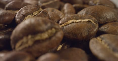 Close-Up-of-Coffee-Beans-Moving-Past-Camera