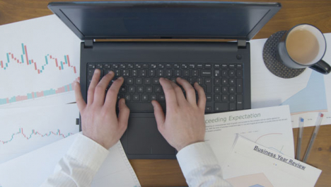 Male-Hands-Slowly-Typing-on-Laptop