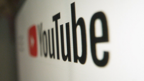 Close-Up-Pan-of-Youtube-Logo-on-Screen