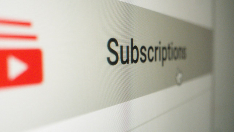Close-Up-Clicking-on-Youtube-Subscriptions-button-on-Sidebar