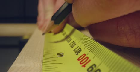 Using-Tape-Measure-to-Mark-Wood