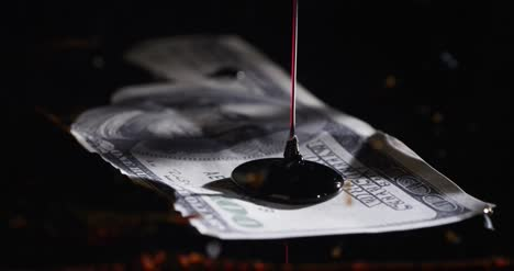 Oil-Being-Poured-Onto-100-Dollar-Bill