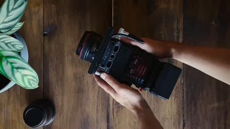 Flat-Lay-Filmmaker-Grabs-Camera