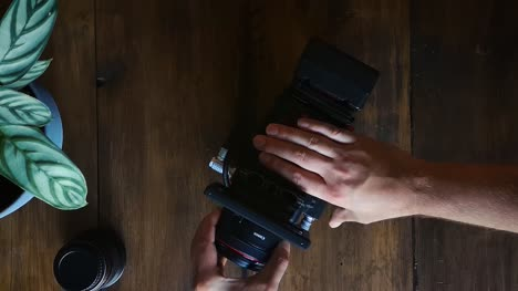 Flat-Lay-Filmmaker-Mounts-Lens-onto-Camera
