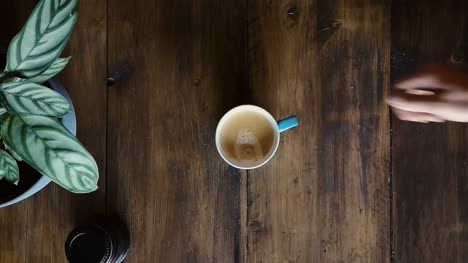 Flat-Lay-Placing-Coffee-Cup-With-Lens