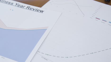 Close-Up-Business-Reports-and-Analysis-on-Desk