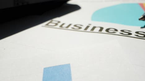 Extreme-Close-Up-Business-Report-on-Paper-with-Pen