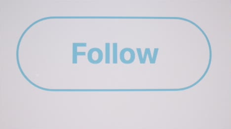 Close-Up-Clicking-Twitter-Follow-Button-on-Screen