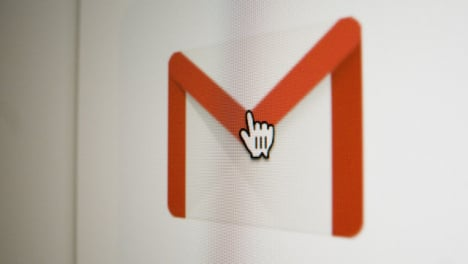 Close-Up-Pan-Clicking-on-Google-Gmail-Icon-on-Screen