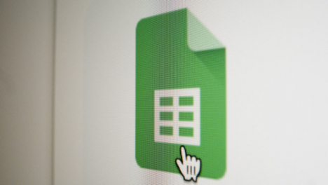 Close-Up-Pan-Clicking-on-Google-Sheets-Icon-on-Screen