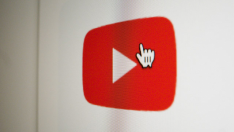 Close-Up-Pan-Clicking-on-Google-Youtube-Icon-on-Screen