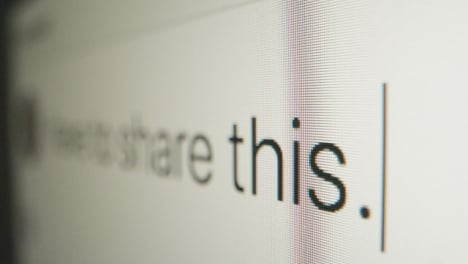 Close-Up-Typing-in-Facebook-Post-on-Screen