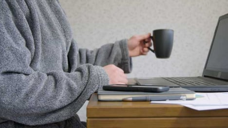 Male-Working-From-Home-Drinking-From-Cup