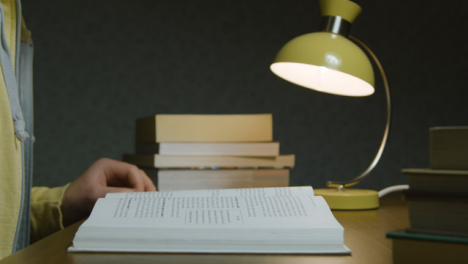Side-View-Pan-of-Book-on-Table