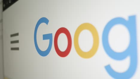 Close-Up-Pan-of-Google-Logo-on-Screen