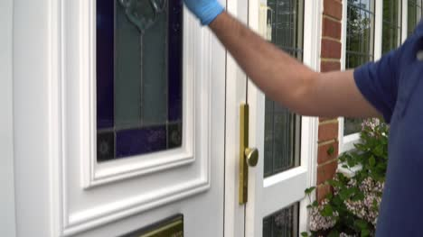 Courier-Knocking-On-Door-To-Deliver-Parcel