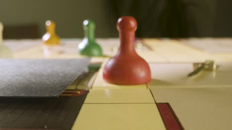 Close-Up-Rolling-Die-and-Moving-Pawn-in-Cluedo-Game