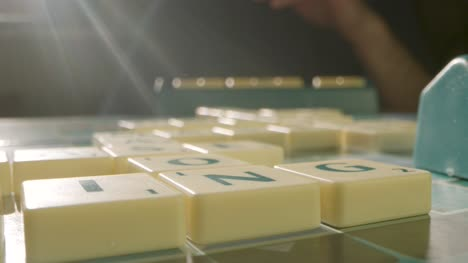 Close-Up-Two-People-Playing-Board-Game-Scrabble