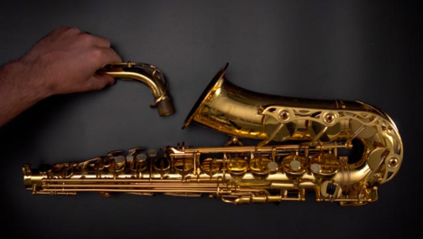 Flat-Lay-Saxophone-Being-Placed-On-Flat-Surface
