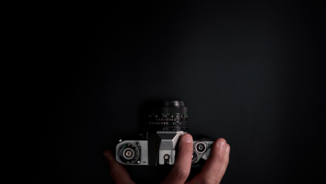 Flat-Lay-Retro-Camera-Placed-On-Surface-Top-Copy-Space