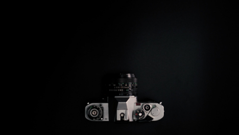 Flat-Lay-Stop-Motion-Retro-Camera-Moving-On-Surface