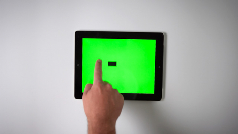 Flat-Lay-Tablet-Green-Screen-Finger-Pulling-Down