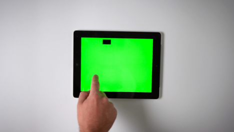 Flat-Lay-Tablet-Green-Screen-Finger-Scrolling-Left