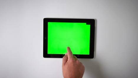 Flat-Lay-Tablet-Green-Screen-Finger-Moving-Top-Right-