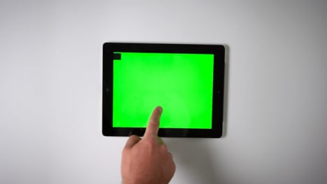 Flat-Lay-Tablet-Green-Screen-Finger-Moving-Left