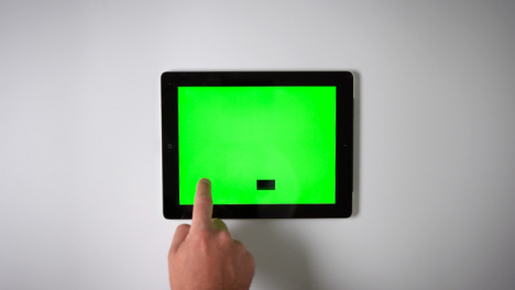 Flat-Lay-Tablet-Green-Screen-Finger-Scrolling-Down