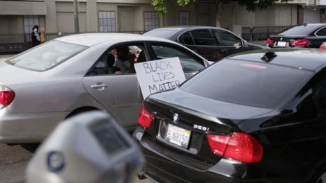 Hollywood-Man-Offering-Water-From-Car-During-Protest
