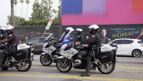 Hollywood-Waiting-Police-Motorbike-Convoy-During-Protests
