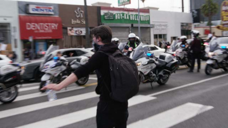 Hollywood-Man-Stopping-a-Protester-Approaching-Police