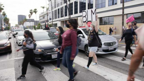Hollywood-People-with-Protest-Signs-Crossing-Road