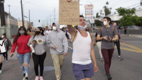 Hollywood-Male-Chanting-and-Carrying-Anti-Racism-Sign-During-Protest