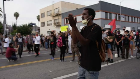 Hollywood-Black-Man-Clapping-To-Protesters-Chanting-During-Protest