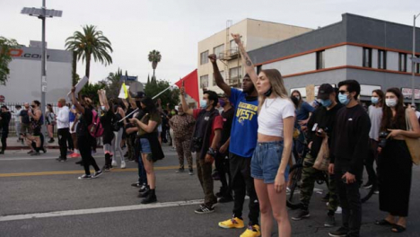 Hollywood-Protester-Holding-Arms-Up-During-Protest