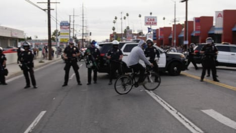 Hollywood-Man-Cycles-in-Front-of-Police-During-Protest