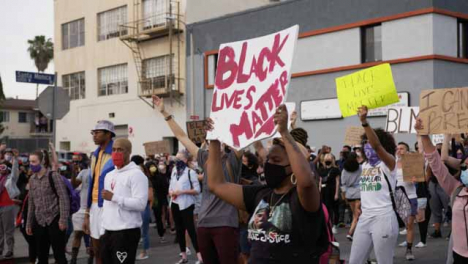 Hollywood-Black-Woman-Holding-Black-Lives-Matter-Sign-During-Protest