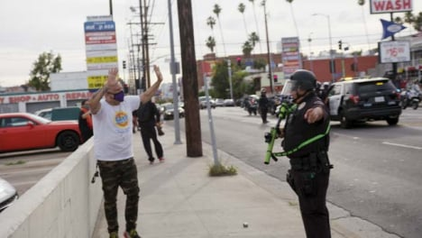 Hollywood-Police-Officer-Ushers-Protester-to-Move-During-Protest
