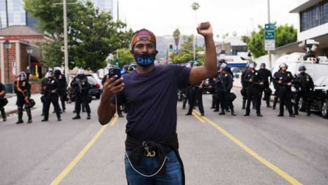 Hollywood-Portrait-of-Protester-in-Front-of-Police