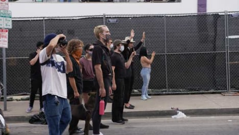 Hollywood-Protesters-Stand-Facing-Police-During-Protest
