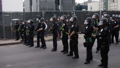 Hollywood-Police-Officers-Standing-Holding-Batons-During-Protest
